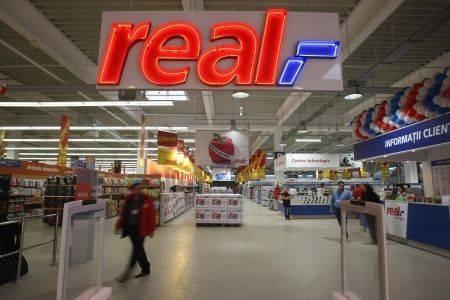 Tranzactie de 1,1 miliarde euro in retail. Magazinele Real trec sub brandul Auchan
