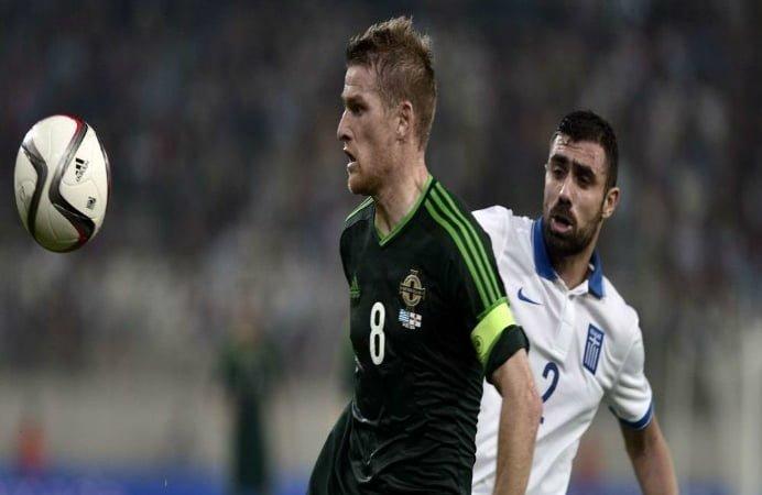 Anghel Iordanescu are serioase motive de fericire! Capitanul Irlandei de Nord s-a accidentat si este incert pentru meciul cu Romania! Uite ce a patit fotbalistul
