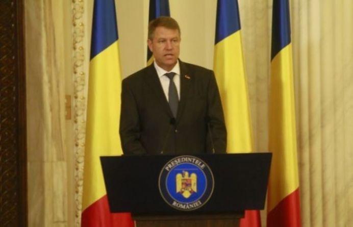 Presedintele Iohannis tocmai a SCAPAT DE DATORII mii de romani! Vezi ce lege a promulgat!