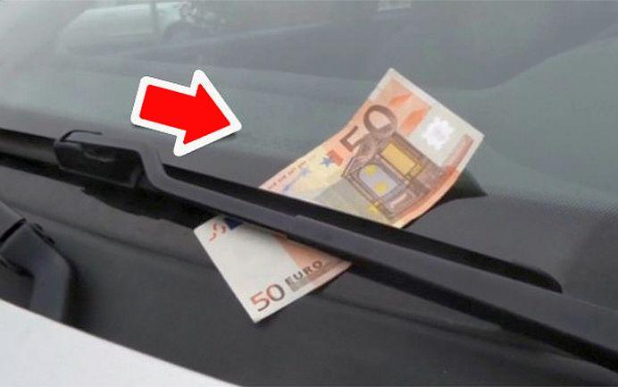 Escrocheria care a impanzit Europa! Tu ce faci daca vezi 50 de euro pe parbriz?